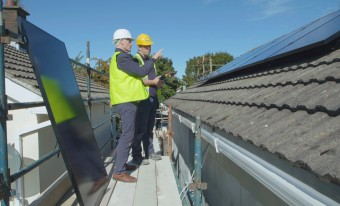 Engineers inspecting solar PV panels